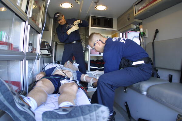 Medics from Tucson Fire Department treating a patient in an ambulance