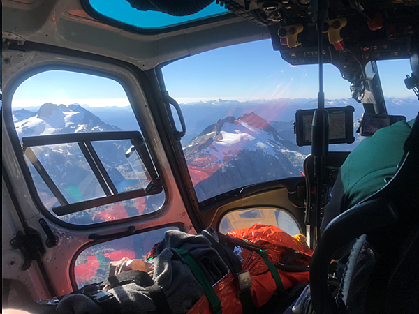 helicopter rescue team above the snow mountain