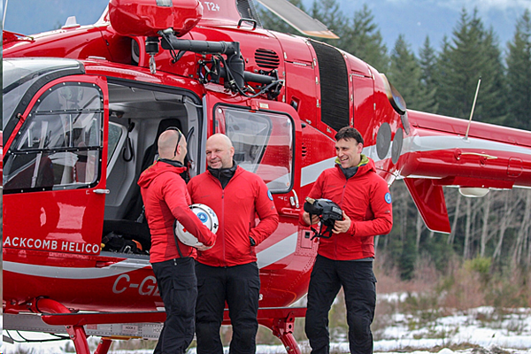 red helicopter with the rescue team