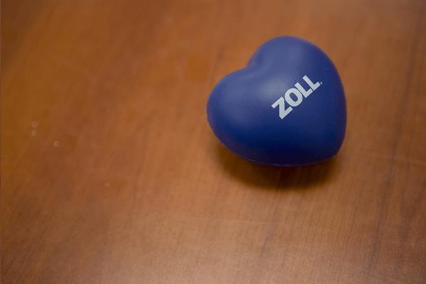 ZOLL Data heart shape ball on a wooden table