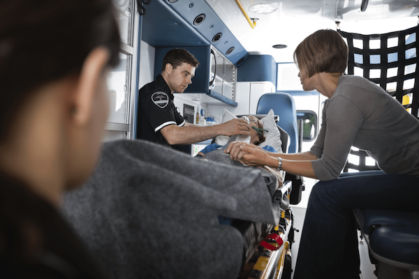 Medic looking after patient in ambulance